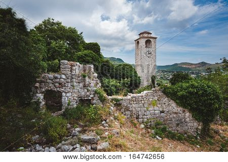 Ancient stone ruins and clock tower at Old Bar town, Montenegro. Stari Bar - ruined medieval city on Adriatic coast, Unesco World Heritage Site.