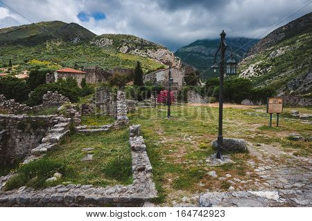 Cloudy mountains and ancient stone ruines of Old Bar town, Montenegro. Stari Bar - ruined medieval city on Adriatic coast, Unesco World Heritage Site.