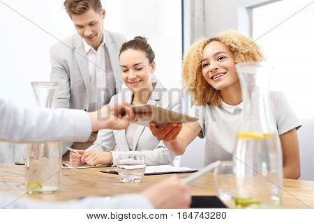 Business woman at a business meeting Intern. Young female employee on probation in a corporation