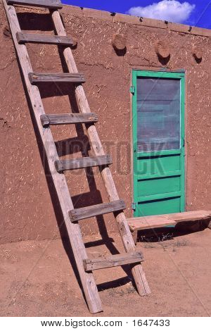 Adobe House With Ladder