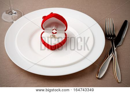 Golden Ring In Beautiful Box On White Plate.