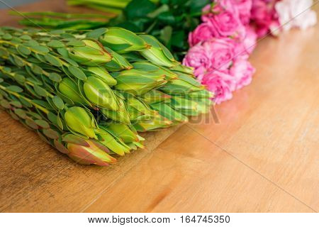 Flower shop background. Fresh buds and roses for bouquet delivery. Floral design studio, making decorations and arrangements.