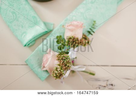 groom's wedding accessories. cufflink and boutonniere for wedding