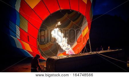 Cappadocia, Turkey - November 15, 2014:  Hot Air Balloon being hot air filled with flames