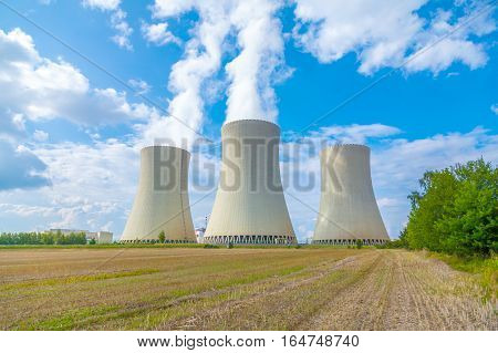 Thermal power plant with cloudy sky, tree