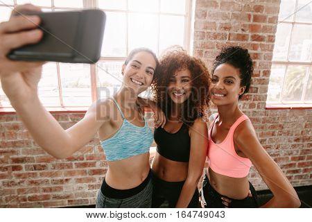 Happy Young Girls In Sportswear Taking Selfie In Gym