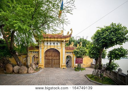 Hanoi, Vietnam - December 04, 2015: Tran Quoc pagoda in early morning in Hanoi, Vietnam. This pagoda is located on a small island near the southeastern shore of West Lake. This is the oldest Buddhist temple in Hanoi.