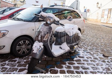 moped under the snow in Prague January 2016