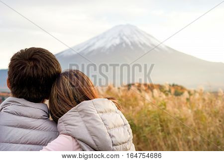Asian couple love and valentines day concept - Asian lovely couple in love feeling with fuji mountain in day light background and copy space. Use for love and couple artwork.