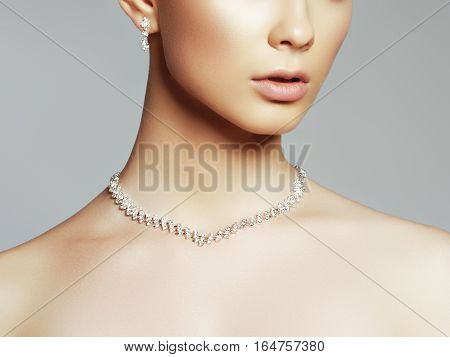 The Beautiful Woman In Expensive Pendant Close-up