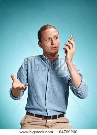 The Young Surprised Caucasian Man On Blue Background