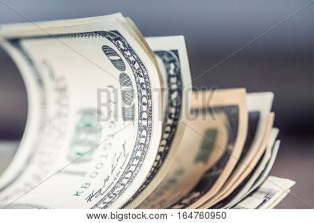 Dollars banknotes closeup. Cash Money American Dollars.Close-up view of stack of US dollars.
