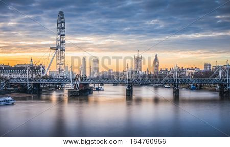 London skyline toward embakment bridge and big ben as seen from waterloo bridge at sunrise