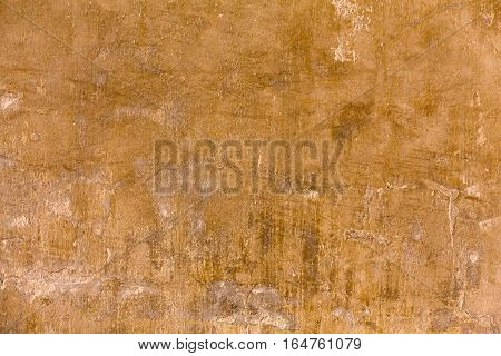 Clay eathern wall abstract background. Old weathered grunge texture, natural eco house plaster. House exterior