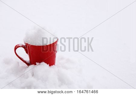 image of a red mug in snow
