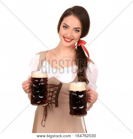 young sexy woman wearing a dirndl with two beer mugs isolate.