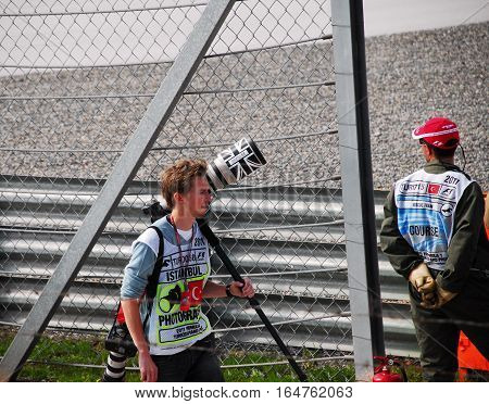 ISTANBUL/TURKEY-MAY 8, 2011 : Photographer of Formula-1 DHL Turkish Grand Prix race and spectacle in Istanbul Park Circuit.