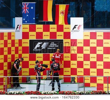 ISTANBUL/TURKEY-MAY 8, 2011 : Race Winners (1st Sebastian Vettel-2nd Mark Webber-3rd Fernando Alonso) at the Istanbul Park Podium of Formula-1 DHL Turkish Grand Prix.