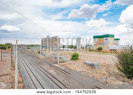 MODDERRIVIER SOUTH AFRICA - DECEMBER 25 2016: The railroad station and grain silos at Modderrivier a village in the Northern Cape Province