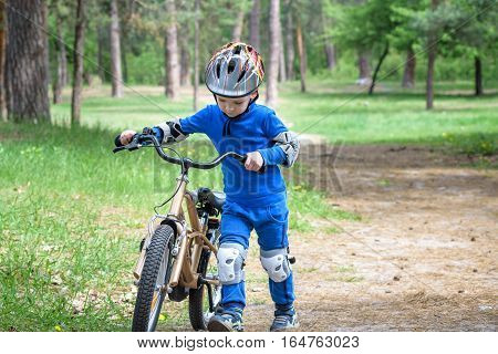 Bicycle Accident. Kids Safety Concept. Boy Transporting His Bike To Repair Place