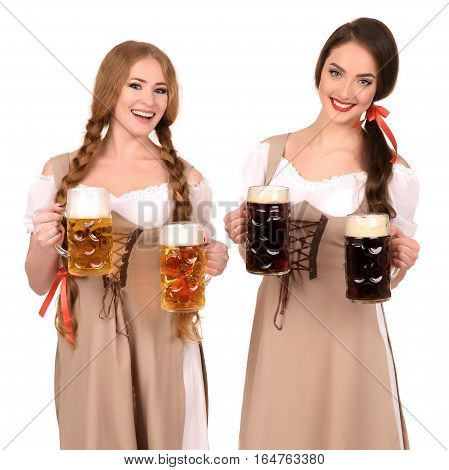 Two beautiful blond and brunette girls of oktoberfest beer stein.