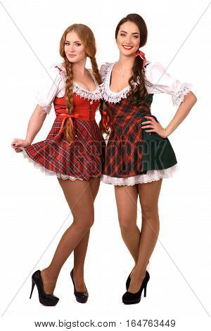 Two beautiful blond and brunette girls of oktoberfest.