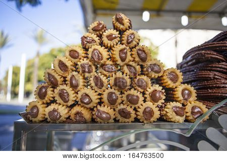 Chocolate filling spanish churros ready to be served at fair stall Seville Spain