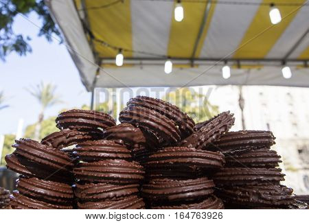 Chocolate coated spanish churros ready to be served at fair stall Seville Spain
