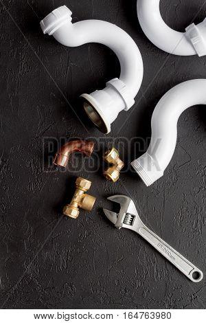 concept plumbing work top view on dark background.