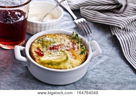 Casserole with vegetables on a textile background. Selective focus.