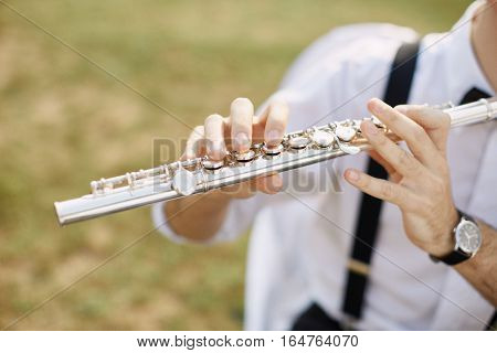 Young Man Playing A Clarinet Or Flute