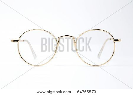 classic round golden Glasses on white background