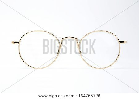 gold classic round glasses on white background