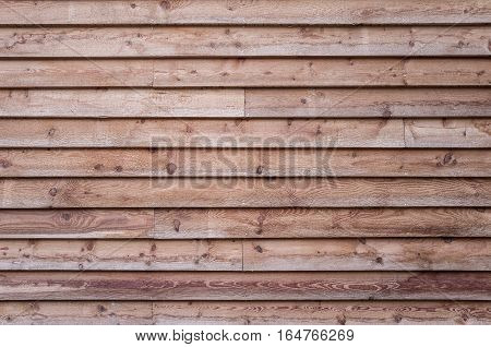 Spruce wood background, wooden slats, spruce wood house facade