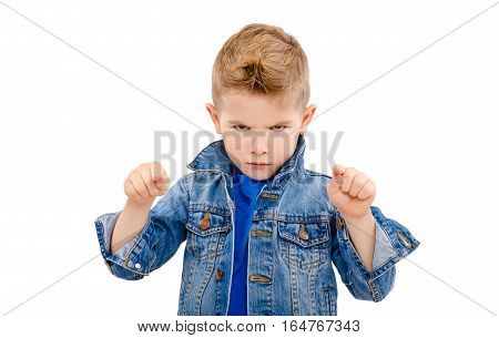 Portrait of a serious attractive boy pointing fingers isolated on white background