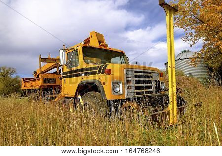 SHELDON , NORTH DAKOTA, September 29, 2016: The old  commercial truck with a front blade is a product of the International Harvester Company which was a United States manufacturer of agricultural machinery, construction equipment, trucks, and formed I