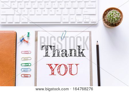 Text Thank you on white paper background / business concept