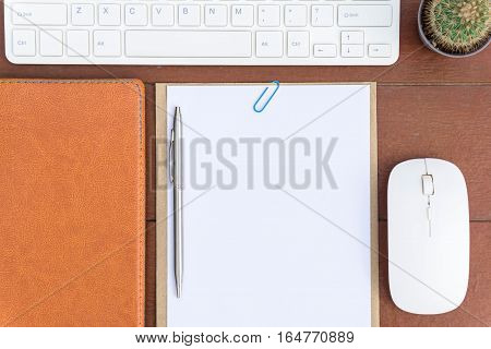 Office desk table with computer keyboard, office supplies on white background Top view.
