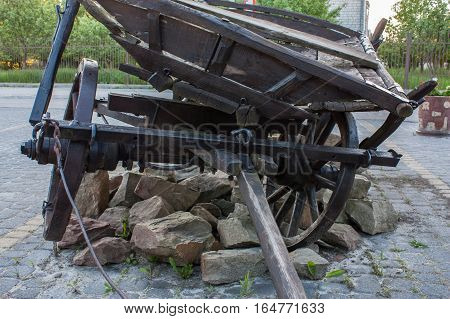 old cart ran over a pile of rubble, Ukraine