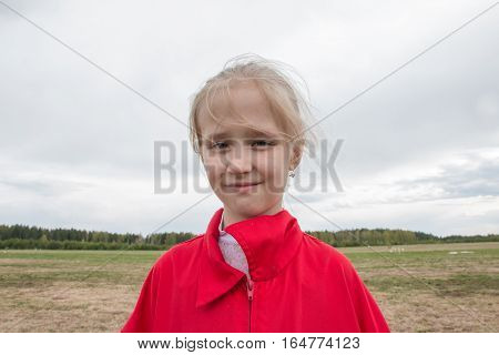 Gerl In Red Jacket And Cloudy Sky