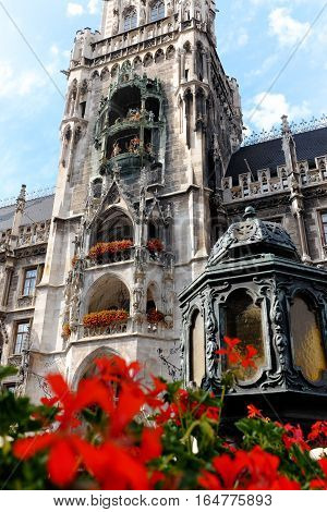 The Munich Rathaus-Glockenspiel located on the Marienplatz on a summer afternoon. The Rathaus-Glockenspiel, part of the new city hall, is known for its multiple daily performances in which figurines tell stories.