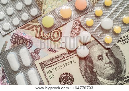 Pills and money.High costs of expensive medication concept