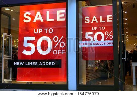 Basingstoke, Uk - January 04 2017: Shop Fronts Of Uk Fashion Stores With 50% Off Sale Signs