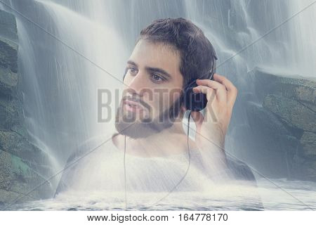 Man listening relaxation music by headset in nature at waterfall double exposure
