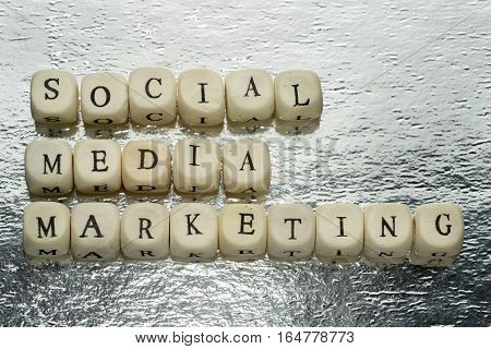 Social Media Marketing Text On A Wooden Cubes On A Shiny Silver Foil Background