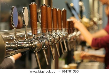 Metal Taps With The Wooden Handle For Draft Beer In The Pub