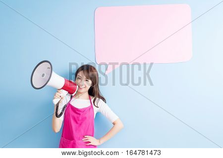 beauty housewife take billboard and microphone isolated on blue background