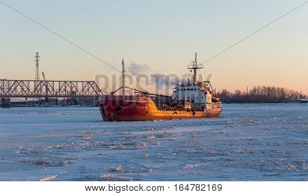 Icebreaker in the river ice. Panoramic view