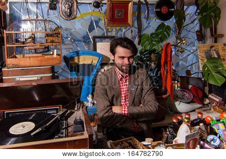 Kolomna Russia - January 03 2017: Seller of flea market located in heart of tourist route near to Kolomna Kremlin waiting for customers