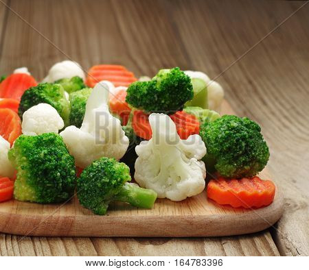 Different vegetables frozen on a cutting board closeup